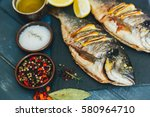 grilled fish | Shutterstock . vector #580964710