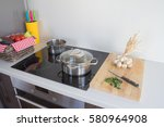 pots on kitchen stove | Shutterstock . vector #580964908