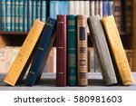 collection of old books in the... | Shutterstock . vector #580981603