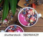 acai smoothie bowls on wooden... | Shutterstock . vector #580984429