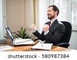 very happy man in front of his...   Shutterstock . vector #580987384
