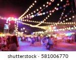 light bokeh of people sitting... | Shutterstock . vector #581006770
