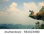 successful woman hiker enjoy... | Shutterstock . vector #581023480