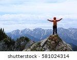 successful woman hiker enjoy... | Shutterstock . vector #581024314