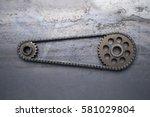 two rusty metal gears linked... | Shutterstock . vector #581029804