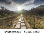 sunset in the woods corridor | Shutterstock . vector #581034250