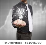 hands of business person... | Shutterstock . vector #581046730