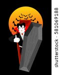 dracula in coffin thumbs up... | Shutterstock . vector #581069188