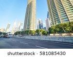 asphalt road and modern...   Shutterstock . vector #581085430