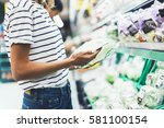 young woman shopping healthy... | Shutterstock . vector #581100154