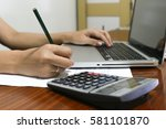 woman working with calculator ... | Shutterstock . vector #581101870