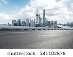 empty highway with cityscape... | Shutterstock . vector #581102878