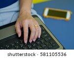hand woman laptop | Shutterstock . vector #581105536