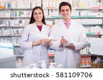 portrait of smiling pharmacist... | Shutterstock . vector #581109706
