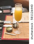 Small photo of Alcoholic beverage in focus, on table place mat near cannibus and related accessories.