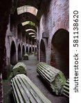 Small photo of Lying Doric columns in undergrounds of the amphitheater in Pozzuoli (Naples, Italy)