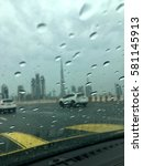driving in rain  dubai  uae | Shutterstock . vector #581145913