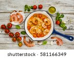 fried shrimp with tomatoes and... | Shutterstock . vector #581166349