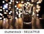 handsome man holding glass of... | Shutterstock . vector #581167918