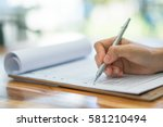 hand with pen over application... | Shutterstock . vector #581210494