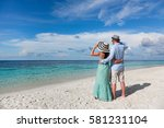 couple on vacation walking on a ... | Shutterstock . vector #581231104