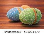 easter eggs on wooden background   Shutterstock . vector #581231470