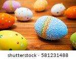 easter eggs on wooden background   Shutterstock . vector #581231488