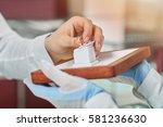 handsome young man buying... | Shutterstock . vector #581236630
