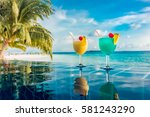cocktail near the swimming pool ... | Shutterstock . vector #581243290