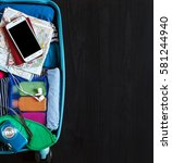 suitcase packed to vacation ... | Shutterstock . vector #581244940