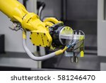 industrial robot with cnc... | Shutterstock . vector #581246470