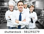 restaurant manager posing in... | Shutterstock . vector #581293279