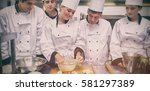 pastry chef showing students... | Shutterstock . vector #581297389