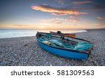 sunset over fishing boats at... | Shutterstock . vector #581309563