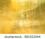 Small photo of Shiny yellow leaf gold foil texture background