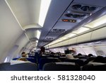 interior of red airplane cabin... | Shutterstock . vector #581328040