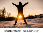 the silhouette of a young boy... | Shutterstock . vector #581334319