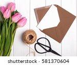 pink tulips  envelope  scissors ... | Shutterstock . vector #581370604