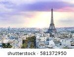 evening eiffel tower and paris... | Shutterstock . vector #581372950