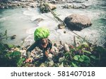 man traveler over river... | Shutterstock . vector #581407018