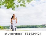 beautiful portrait of brunette... | Shutterstock . vector #581424424