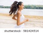 beautiful portrait of brunette... | Shutterstock . vector #581424514