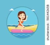 caucasian tourist riding a... | Shutterstock .eps vector #581442658