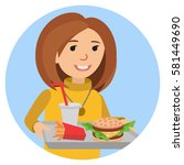 fast food or restaurant. woman... | Shutterstock .eps vector #581449690