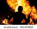 activist with a gun and hatchet ... | Shutterstock . vector #581450860