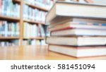 book stack on wood desk and...   Shutterstock . vector #581451094