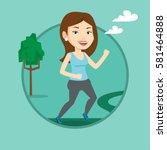 young caucasian woman running.... | Shutterstock .eps vector #581464888