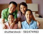 family of four looking at... | Shutterstock . vector #581474983