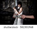Small photo of Human trafficking concept., Person hand with a dollar banknote buying victim woman in pain and bound hands with rope., missing kidnapped., in dark tone.