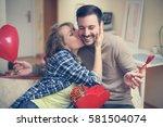 boyfriend gives his girlfriend...   Shutterstock . vector #581504074